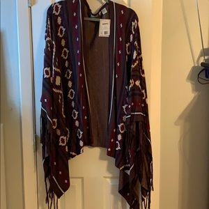 Resistió new With tags poncho